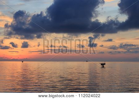 Remote Offshore Production Platforms In Sunset Time With Yellow Sky