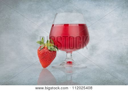 Strawberry And Glass Of Cranberry Juice