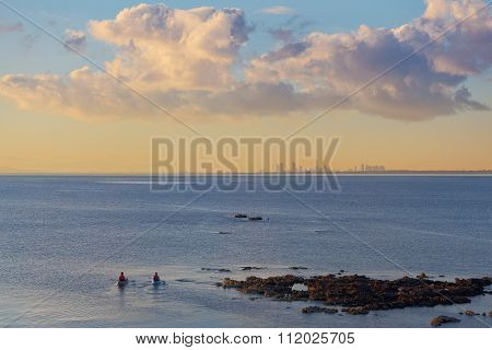 Two Kayakers Paddling At Mornington Peninsula