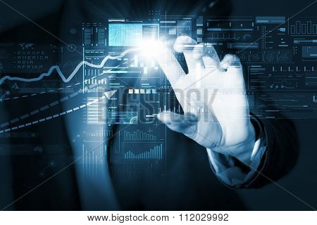 Businesswoman hand touching with finger virtual panel with infographs