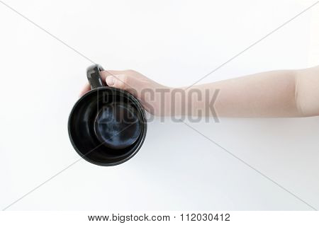 Black mug in hand isolated