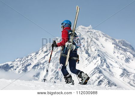 Girl Ski Mountaineer Climb On Mountain On Background Volcano