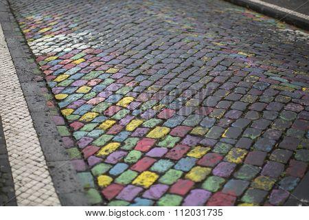 Texture of colorful cobblestones in Ponta Delgada, Azores.