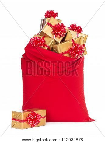 Red Christmas Sack With Wrapped Gift Boxes Isolated On White