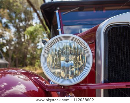 Closeup Of The Headlight And Grill Of A Vintage Car