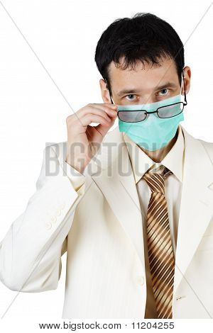 Doctor Of Medical Sciences Is Looking Over Glasses