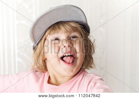Funny Laughing Cute Caucasian Blond Baby Girl In Cap
