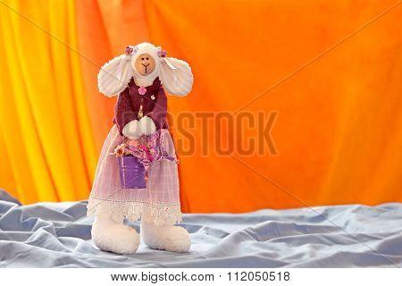 Mom-bunny with purple bucket