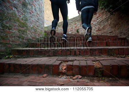 Man And Woman Running Upstairs Together