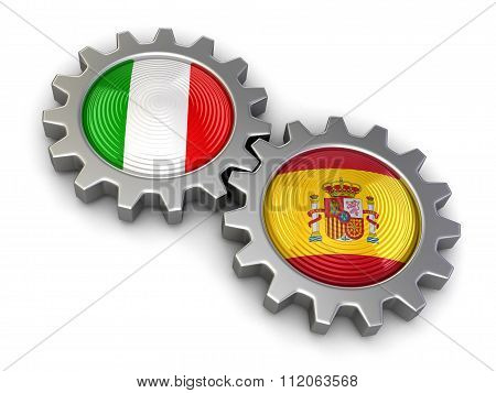 Italian and Spanish flags on a gears. Image with clipping path