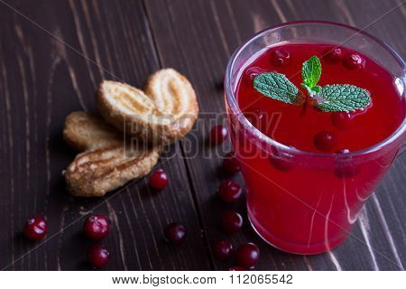 Red cranberry compote in a transparent glass