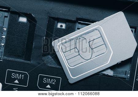 SIM card on slots in mobile phone.