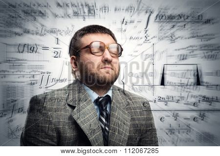 Professor in glasses thinking about math formulas