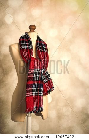 Tartan winter scarf on vintage tailors dummy