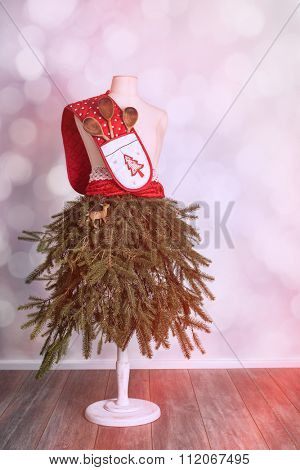 Festive mannequin decorated with baking utensils ready for festive season