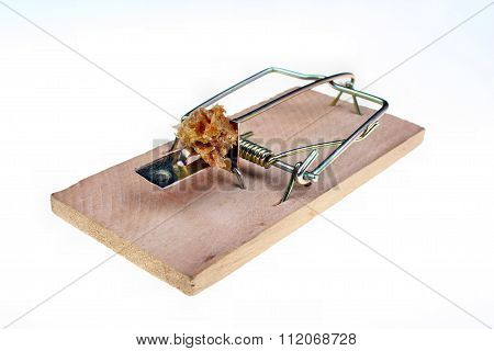 Mousetrap with a piece of bread on a white background