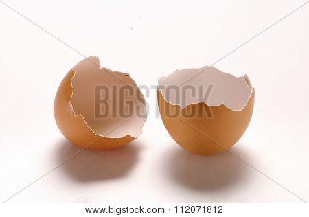 One broken egg isolated on White background.