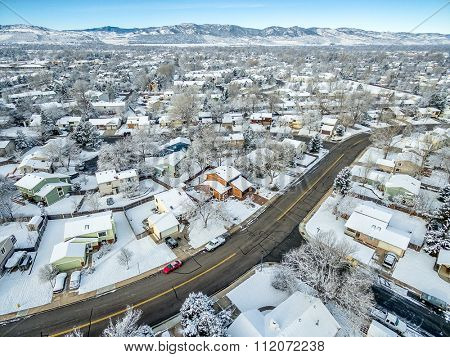 FORT COLLINS, CO, USA - DECEMBER 13, 2015: Aerial  view of typical residential neighborhood along Front Range of Rocky Mountains in Colorado, late fall or winter scenery with snow.