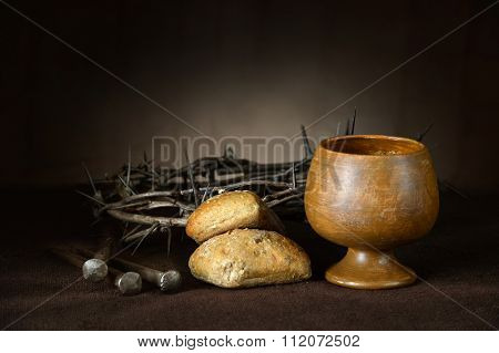 Communion elements with crown of thorns and nails on vintage table