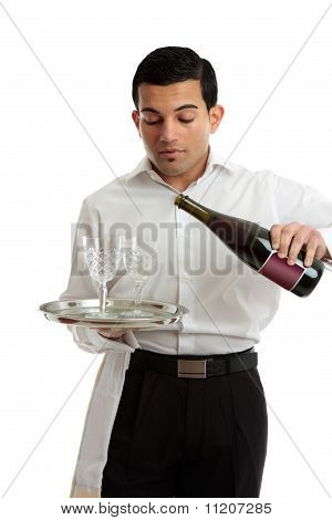 Waiter Or Bartender Pouring Wine