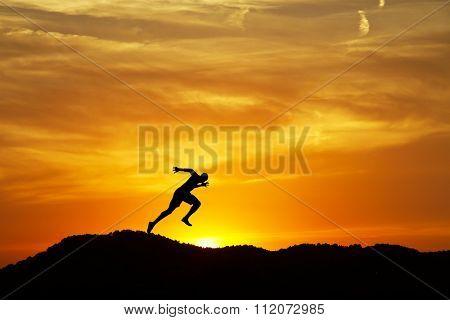 man running down the mountain