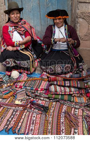 Pisac Market, Peru - May 17, 2015: Two women selling handicraft items in Pisac Market in the Sacred Valley of Peru.