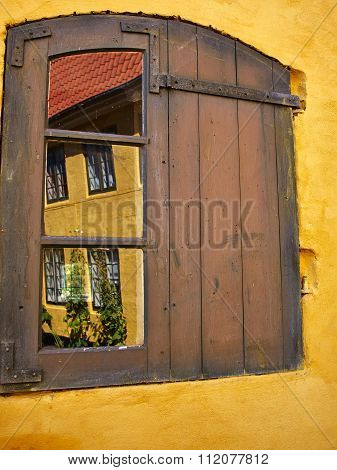 Rustic Window With Wooden Exterior Shutters