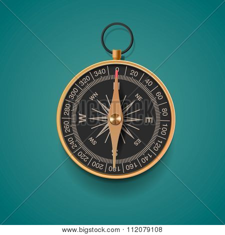 Vintage brass compass, isolated background
