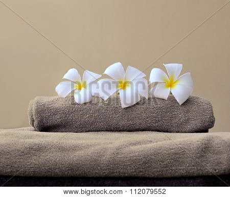 stack of towels with frangipani flowers