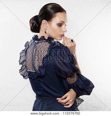 Portrait of elegant beautiful woman on light background
