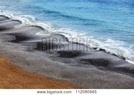 waves on pebble beach in Lima Peru
