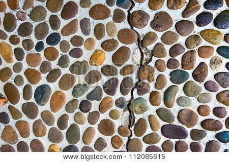 Lot Of Pebbles Around Big Stone