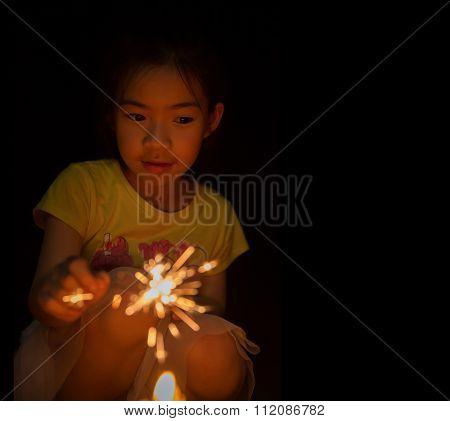 Little Girl Holding Firewors
