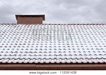 Red Chimney And Roof Covered With Snow