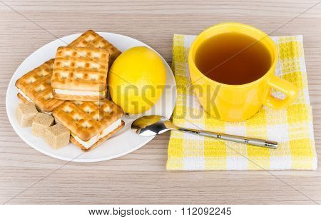 Cup Of Tea On Napkin, Biscuits, Lemon And Lumpy Sugar