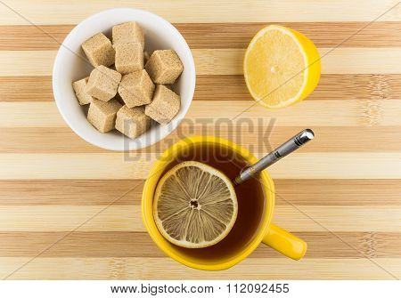 Cup Of Tea With Lemon And Bowl Of Lumpy Sugar