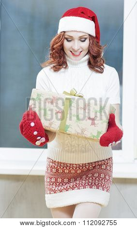 Christmas, New Year, X-mas Concepts And Celebrations. Young Caucasian Smiling Santa Helper Girl With