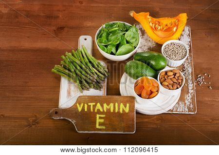 Foods Containing Vitamin E On  Wooden Background.