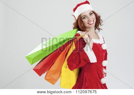 New Year And Christmas Concept And Ideas. Portrait Of Laughing Caucasian Red-haired Santa Girl With
