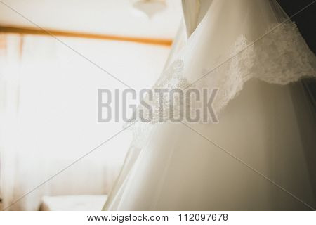 Sepia pastel Toned Close-up of wedding dress details