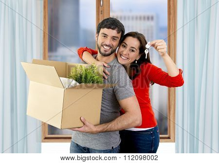 Happy Couple Moving Together In A New House Unpacking Cardboard Boxes