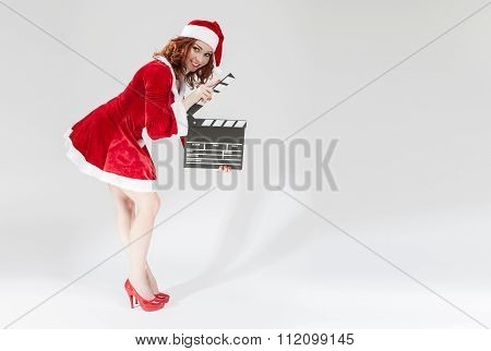 Cinema And Film Production Concept And Ideas. Happy Smiling Female Santa Helper Girl With Actioncut
