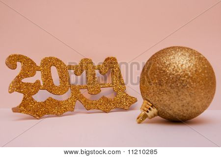 New year with a Christmas ball in gold