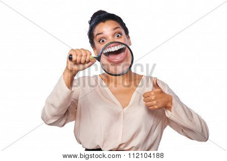 Woman smiling and show teeth through a magnifying glass