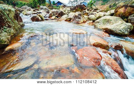 Rapid River with large stone boulders.