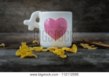 Cup With Heart-shaped/ Love Cup On Wooden Background.