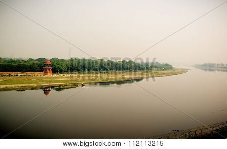 Yamuna river and a man in boat. View from Taj Mahal