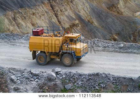 Yellow Truck With Water Cannon On Coper Surface Mining