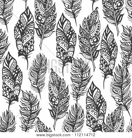Hand drawn vector zentangle doodle black feathers seamless pattern on white.