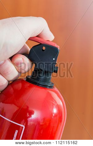 fire extinguisher in human hand. close up